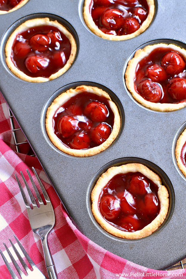 Mini Cherry Tarts recipe ... a delicious + easy dessert with only 4 ingredients! Make these mini cherry pies in muffin tins fast. These cherry tartlets feature a quick cream cheese crust and simple filling. These easy cherry tarts are a recipe your whole family will love! | Hello Little Home