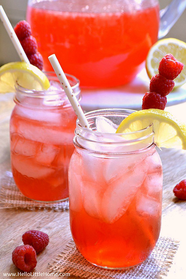 Spiked Raspberry Lemonade recipe ... an easy summer cocktail! This simple spiked lemonade recipe is made from homemade lemonade, vodka, and Torani Raspberry Syrup. Make a pitcher of this pink lemonade in minutes, and you'll have a refreshing party drink that's perfect for a crowd. Serve this spiked lemonade cocktail in mason jars or your favorite glasses for easy summer entertaining! A refreshing raspberry cocktail that's great for happy hour, baby showers, weddings, girls night, and more! | Hello Little Home
