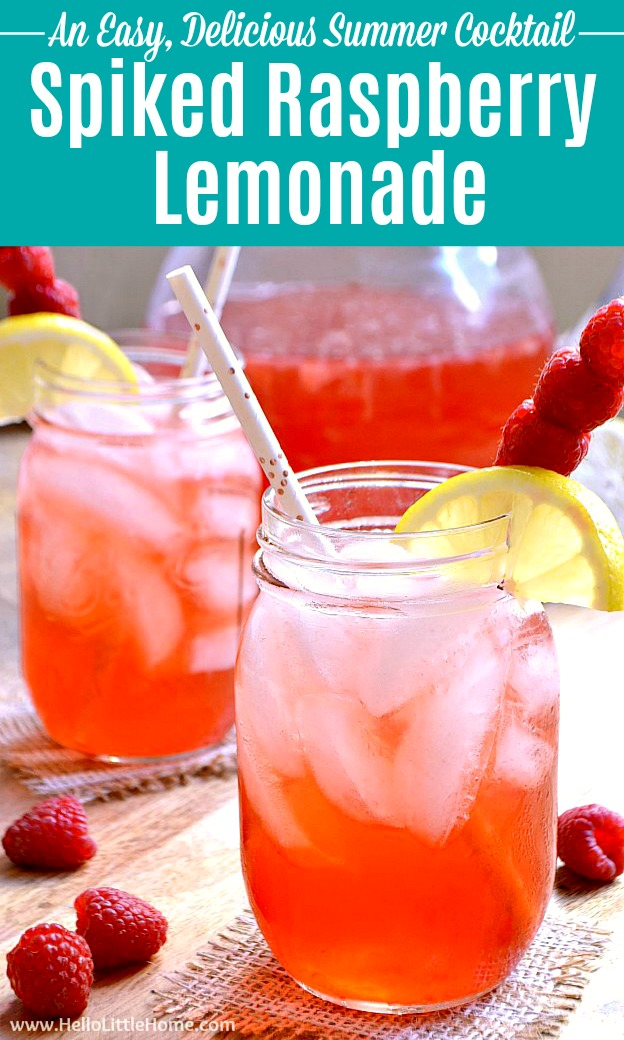 Two glasses of Spiked Raspberry Lemonade with a pitcher in the background.