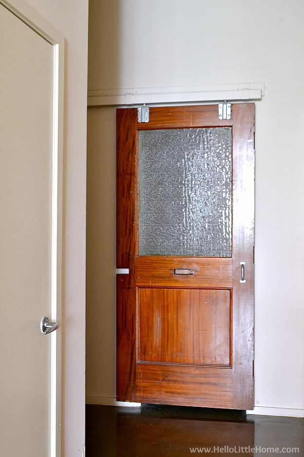 Sliding door to bathroom in loft apartment. | Hello Little Home