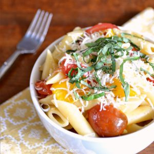 Easy 15 Minute Tomato Basil Pasta recipe! Make this mouthwatering fresh cherry tomato sauce in minutes, then toss it with hot penne and sprinkle with fresh basil and Parmesan cheese (add fresh mozzarella for a Caprese-inspired sauce) ... perfect for weeknight dinners, as well as entertaining. This simple Homemade Tomato Basil Pasta makes a tasty summer meal your whole family with love! | Hello Little Home