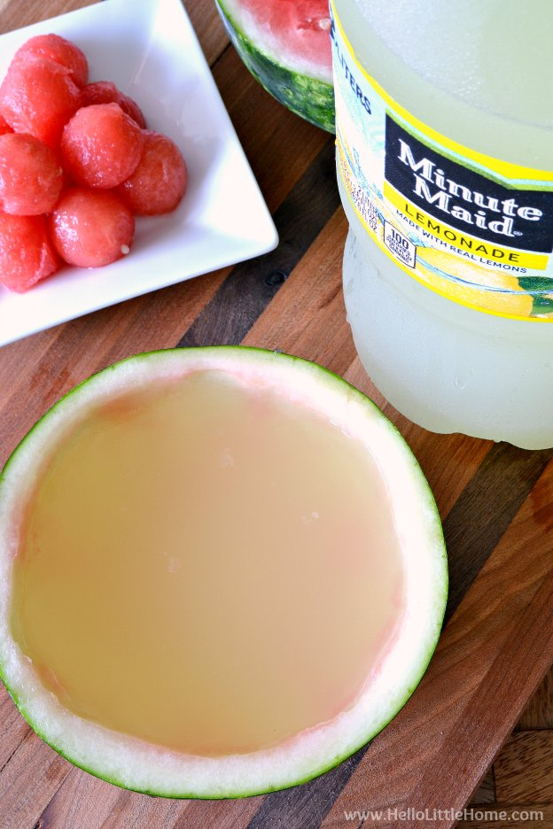 Filling the Mini Watermelon Punch Bowls with Minute Maid Lemonade. | Hello Little Home