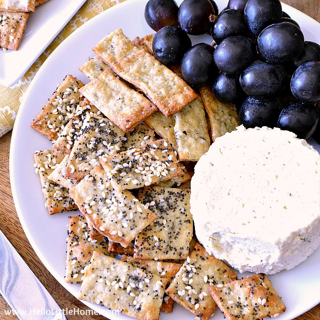 Easy Parmesan Herb Crackers recipe! Learn how to make homemade crackers seasoned with cheese and herbs, like basil, thyme, and garlic, and topped with sesame and poppy seeds. These healthy, artisan crackers take minutes to prepare and make an impressive appetizer or snack! | Hello Little Home