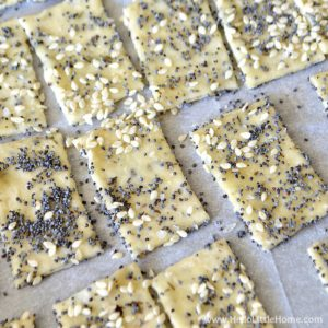 Cutting and adding seeds to Parmesan Herb Crackers | Hello Little Home