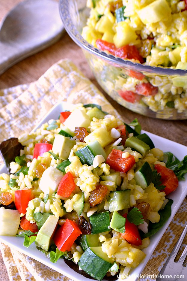 Tropical Rice Salad recipe ... a delicious and easy vegan salad! This healthy cold rice salad is packed with fruits and veggies and features a yummy mango lime vinaigrette. Your whole family will love this summer rice salad recipe! | Hello Little Home