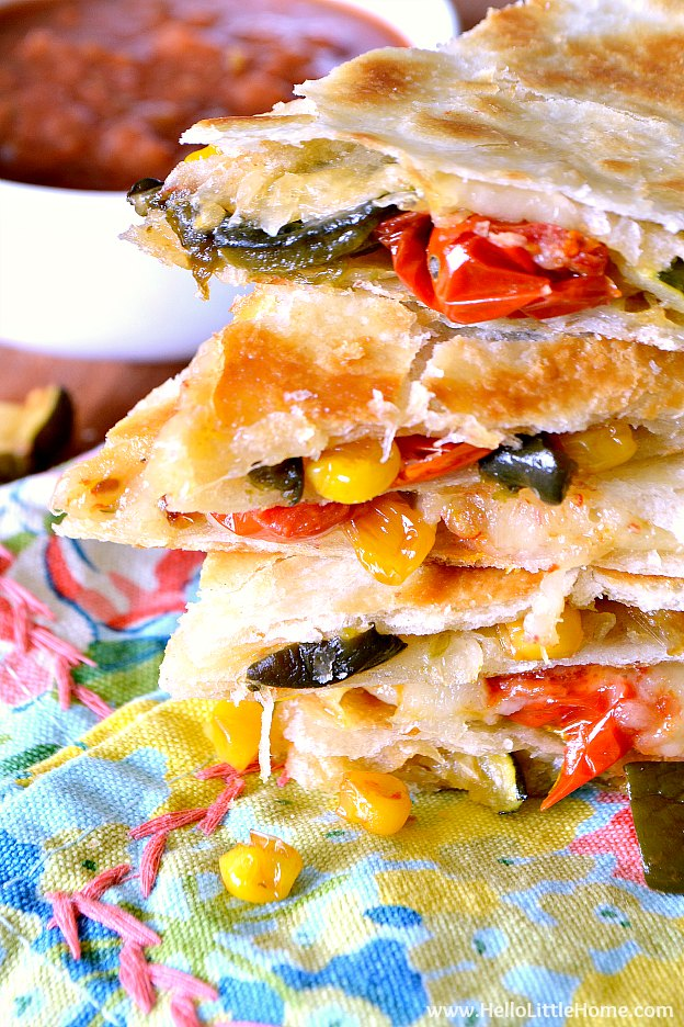 Easy Roasted Vegetable Quesadillas recipe! Learn how to make this delicious veggie quesadilla recipe featuring crispy flour tortillas packed with cheese and roasted zucchini, tomatoes, corn, and poblano peppers. Serve these vegetarian quesadillas with salsa and sour cream for a simple meatless Mexican lunch, dinner, or snack! | Hello Little Home