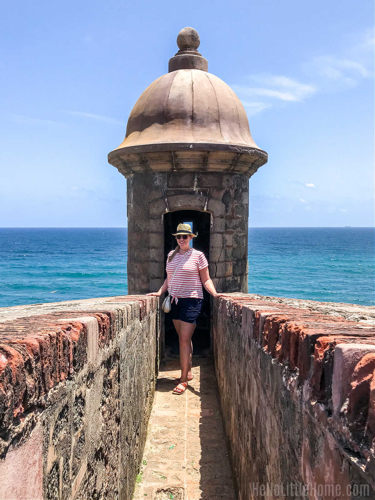 Ginnie the author standing in a garita (sentry box) at the San Juan National Historic Site.