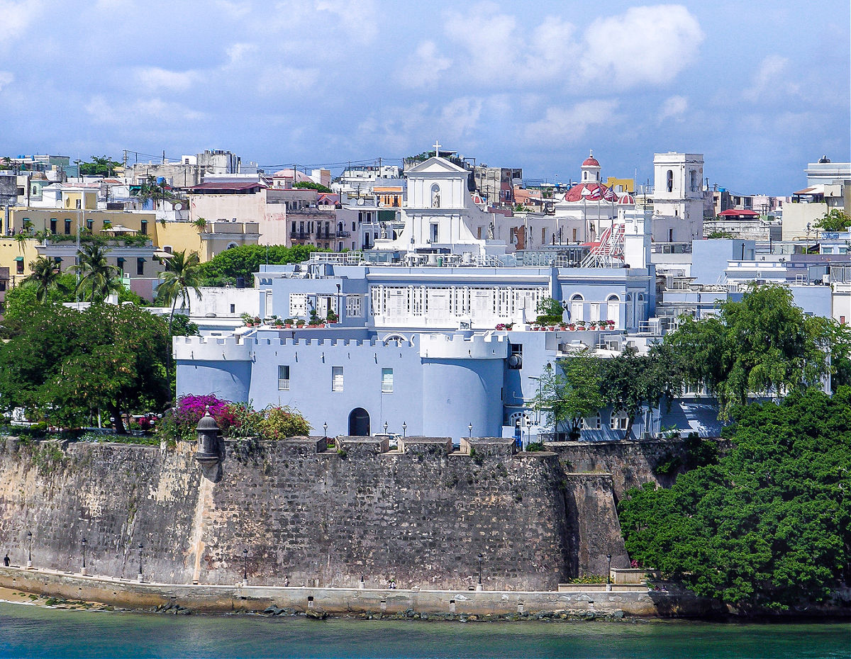 An aerial view of La Fortaleza with Old San Juan behind it.