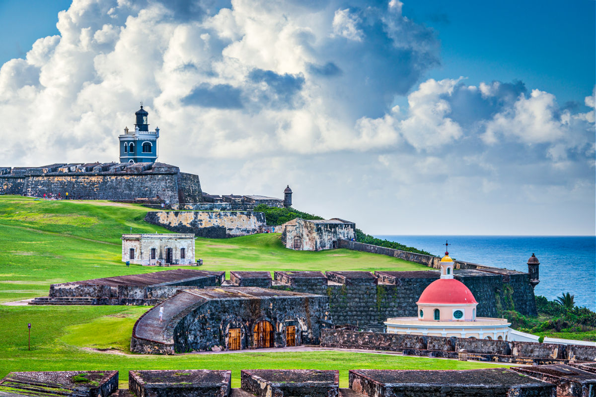 A view of the San Juan City Walls with El Morro in the distance.