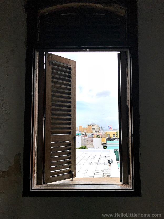 View of Old San Juan through a window in Castillo San Cristóbal, part of the San Juan National Historic Site and one of the best things to do in San Juan, Puerto Rico! | Hello Little Home