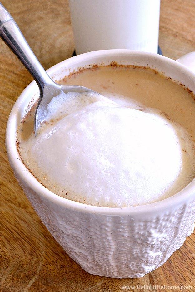 Adding milk foam to a Dirty Chai Latte.   Hello Little Home