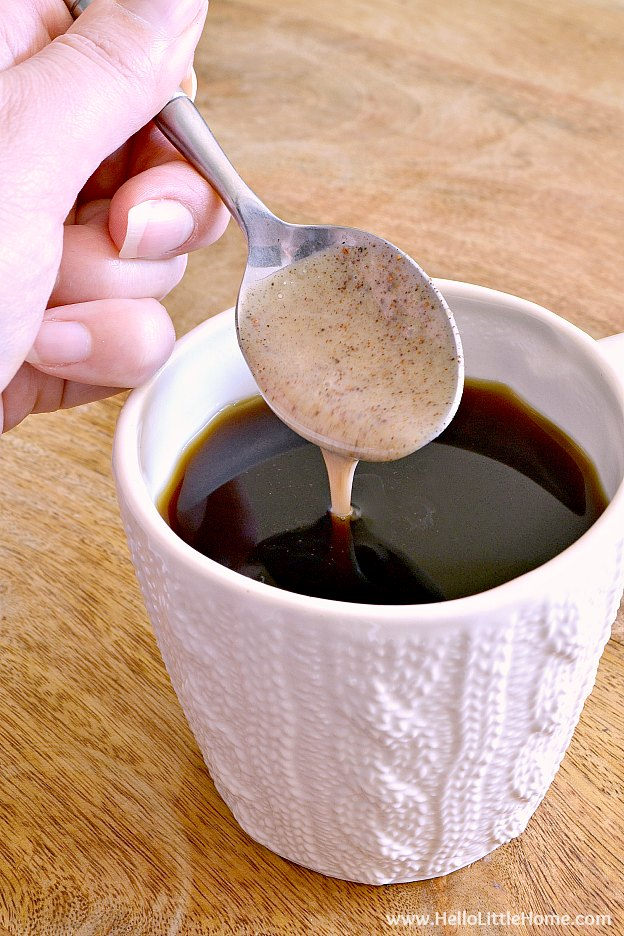 Adding the chai concentrate to the hot coffee.