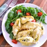 Spinach and Artichoke Stuffed Shells recipe … perfect for a crowd or party! An easy stuffed shells recipe featuring a mouthwatering ricotta, spinach, and artichoke filling. These vegetarian stuffed shells are baked in a decadent, but simple, white sauce. Your whole family will love this baked stuffed shells recipe that's packed with veggies. Makes a great meatless dinner. | Hello Little Home
