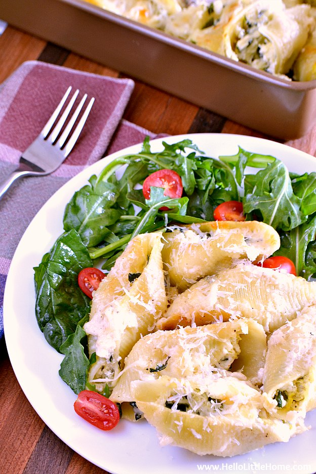 Plate and pan of Spinach Artichoke Stuffed Shells | Hello Little Home