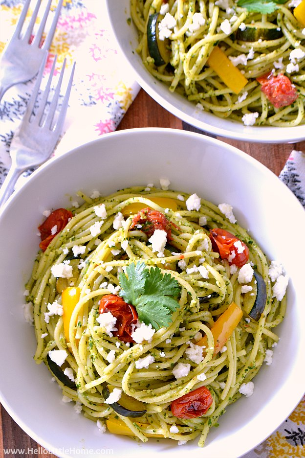 Cilantro Pesto Pasta with Roasted Vegetables ... this delicious and easy vegetarian pesto pasta recipe is packed with flavor! Learn how to make this yummy vegan cilantro pesto sauce is your food processor, then toss it with spaghetti and roasted veggies for a simple, yet delicious meal. This versatile pesto has so many uses beyond pasta, too: toss it with a salad, top a pizza, mix with rice, or serve it as a dip. | Hello Little Home