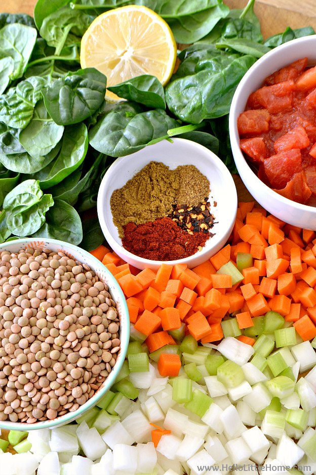 Ingredients for Easy Lentil Soup: Spinach, Lemon, Spices, Tomatoes, Lentils, Carrots, Celery, and Onion