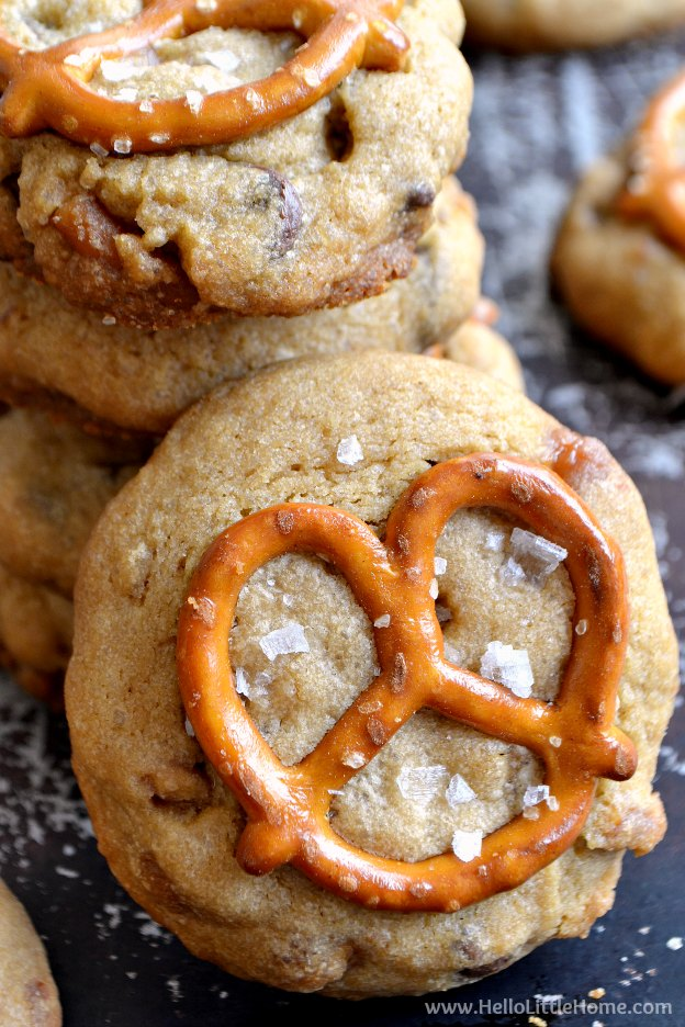 Close up of a Salted Caramel Pretzel Cookie leaning on the stack of cookies.
