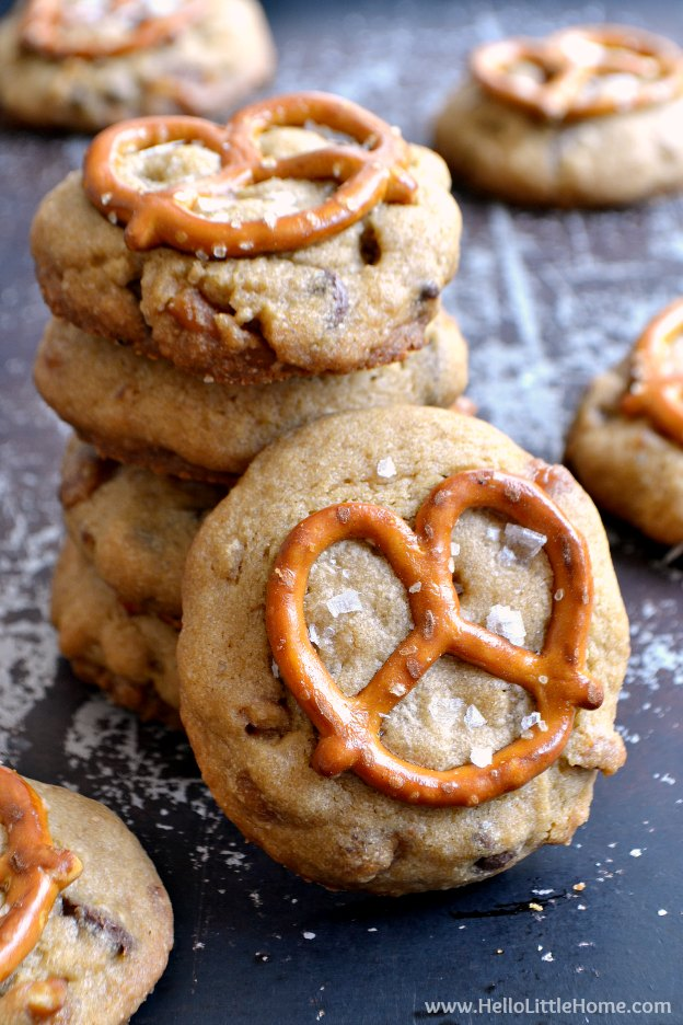 Stack of Salted Caramel Pretzhel Cookies with one in front.