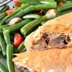 Creamy Mushroom Strudels recipe! These individual strudels are the perfect vegetarian dinner entrée for a special meal, like Thanksgiving or Christmas! Learn how to make this savory vegetable strudel filled with creamy mushrooms wrapped in flaky filo pastry. This easy phyllo dough recipe is a full of delicious veggies in a creamy cheese sauce … an impressive recipe for parties! | Hello Little Home