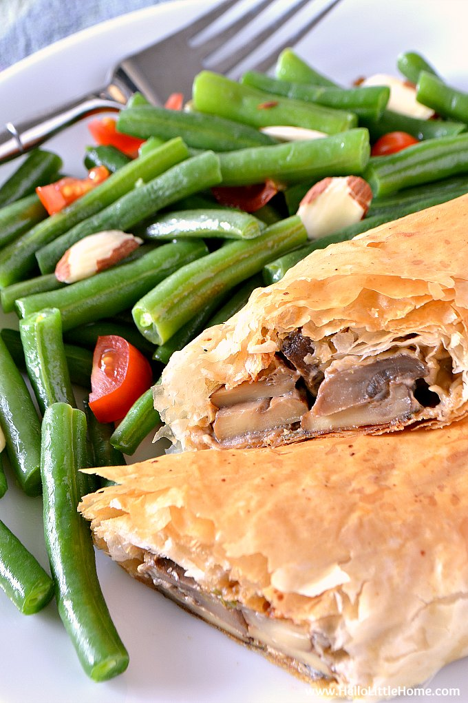 Vegetable Strudel on a plate with green beans. | Hello Little Home