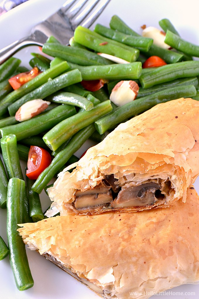Creamy Mushroom Strudel on a plate with green beans | Hello Little Home