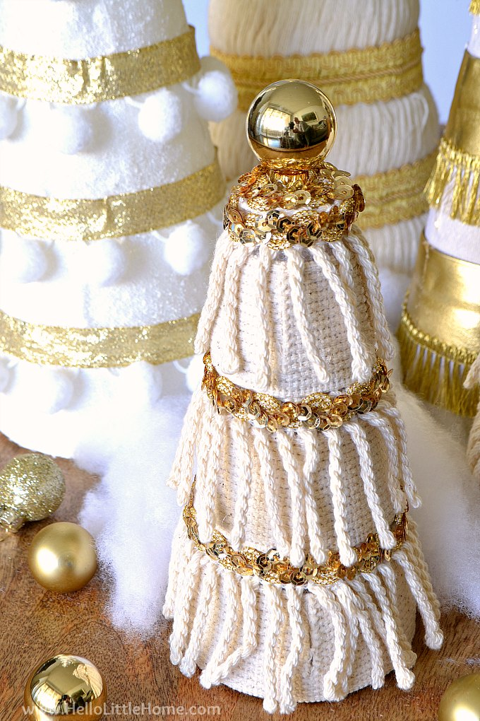 Closeup of small Christmas tree decorated with fringe and sequin trim.