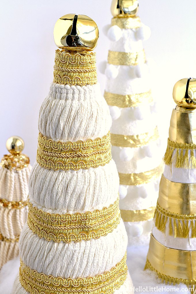 Homemade Mini Christmas Tree decorated with intricate gold trim and cream fringe.