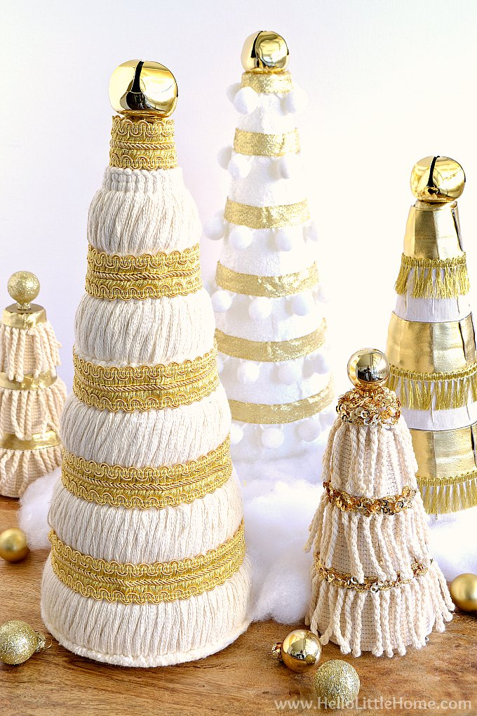 DIY Mini Christmas Trees tutorial! Learn how to make tabletop Mini Christmas Trees, the perfect easy craft for display as a cute centerpiece, on a mantle, on the table, or as a unique holiday decoration anywhere in your home. These cream and gold homemade Mini Christmas Trees can be decorated with trim and ribbon to match any Christmas decor! Creative Christmas tree idea for small spaces, too! | Hello Little Home