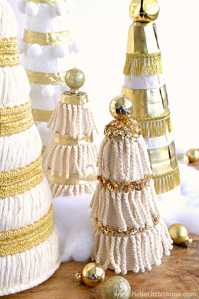 Miniature Christmas Tree decorated with cream fringe, sequin trim, and a mini ornament topper.