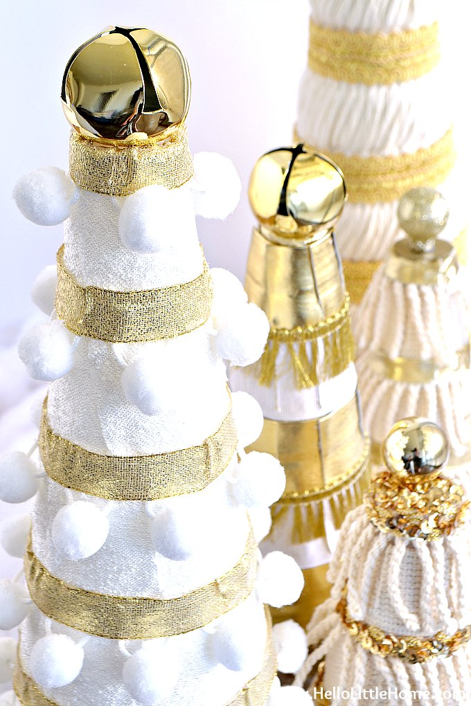 Fun pom pom trim and gold ribbon decorated DIY small Christmas tree.