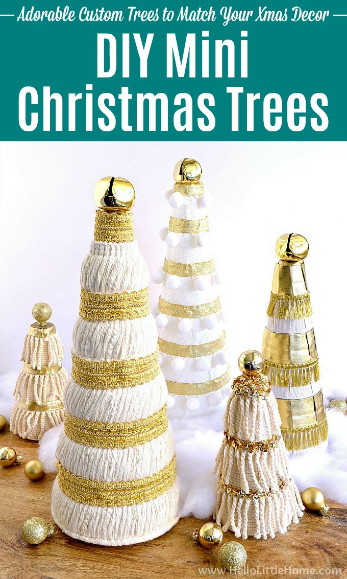 A collection of DIY Mini Christmas Trees on a wood table with faux snow.