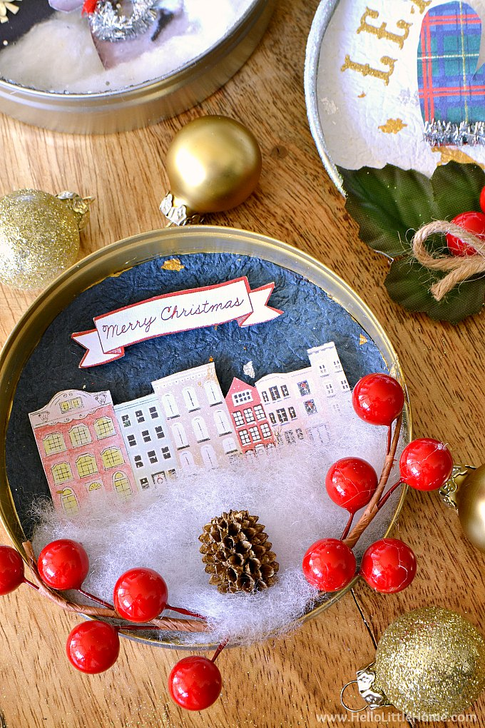DIY Vintage Chrismtas Ornament with cityscape, pinecone, and holly.