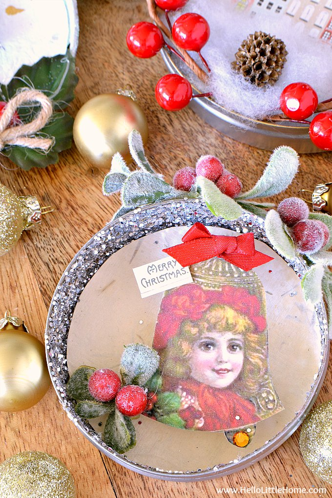 Unique handmade ornament with vintage bell clip art, ribbon, holly, and glitter.