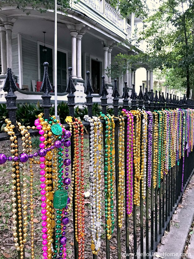 Mardi Gras beads on a wrought iron fence in the Garden District