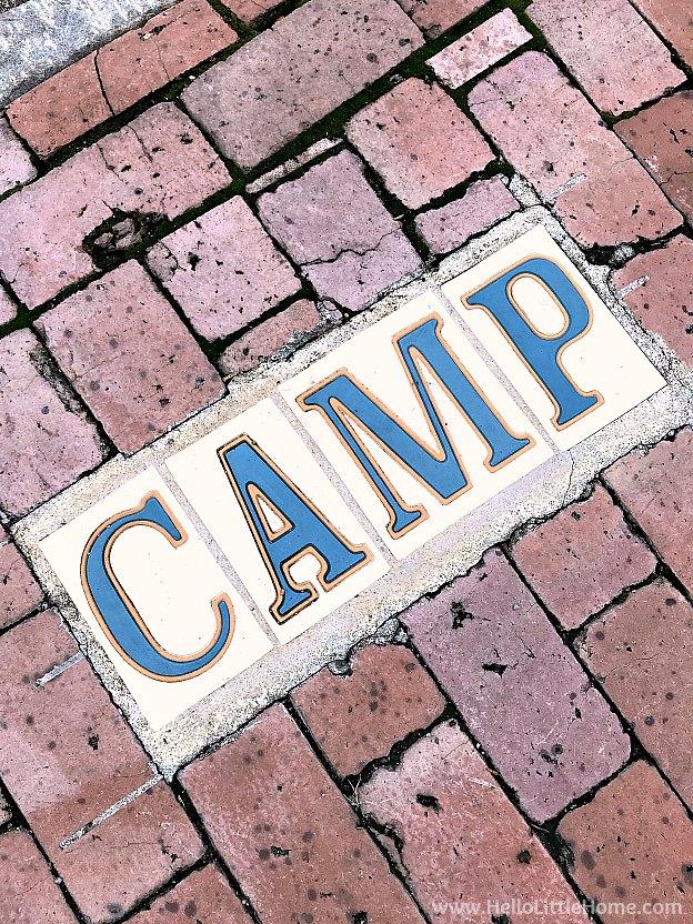 Camp Street tile street sign in sidewalk bricks in the Garden District
