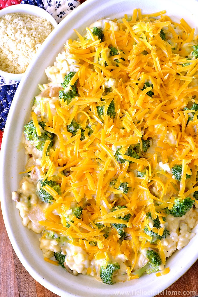 Topping the Broccoli Rice Casserole with Shredded Cheddar Cheese and Panko Bread Crumbs