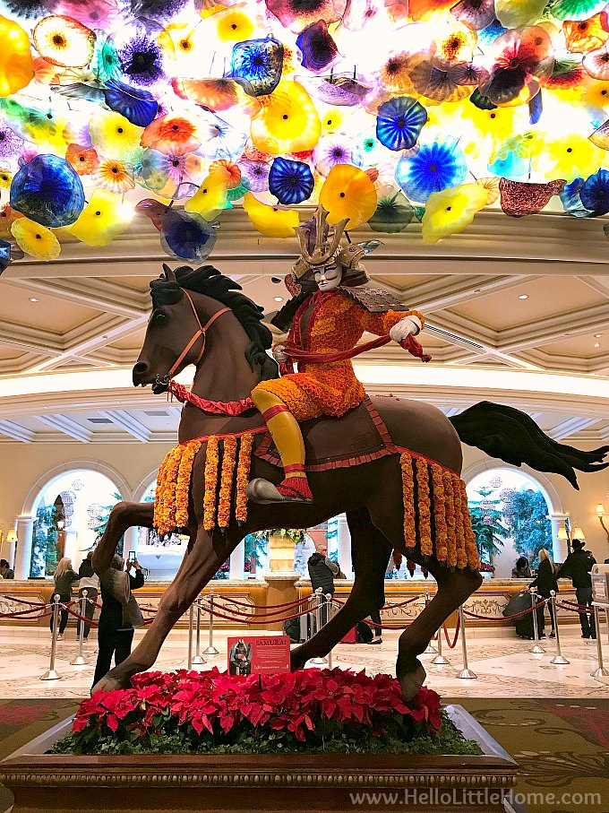 Statue in the Bellagio Lobby Decorated with Poinsettias for Christmas
