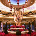 Statues in Caesar's Palace Surrounded by Poinsettias and Christmas Ornaments