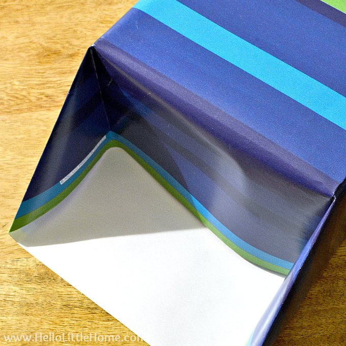 Folding in the wrapping paper on the end of a gift box.