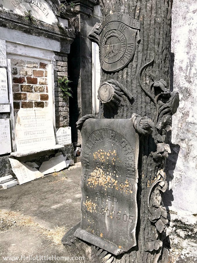 Distinctive Log Shaped Grave Marker with Woodmen of the World Fraternal Emblem at Lafayette Cemetery New Orleans