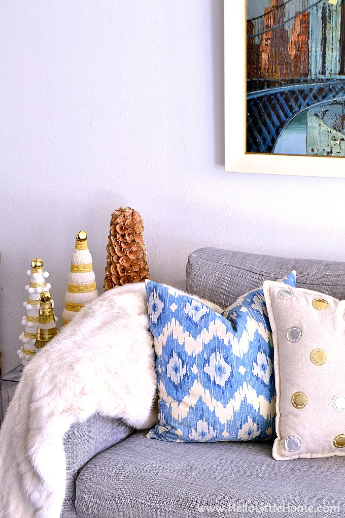 Corner of Couch with Fur Throw, Blue and White Pillow, Gold Polka Dot Pillow