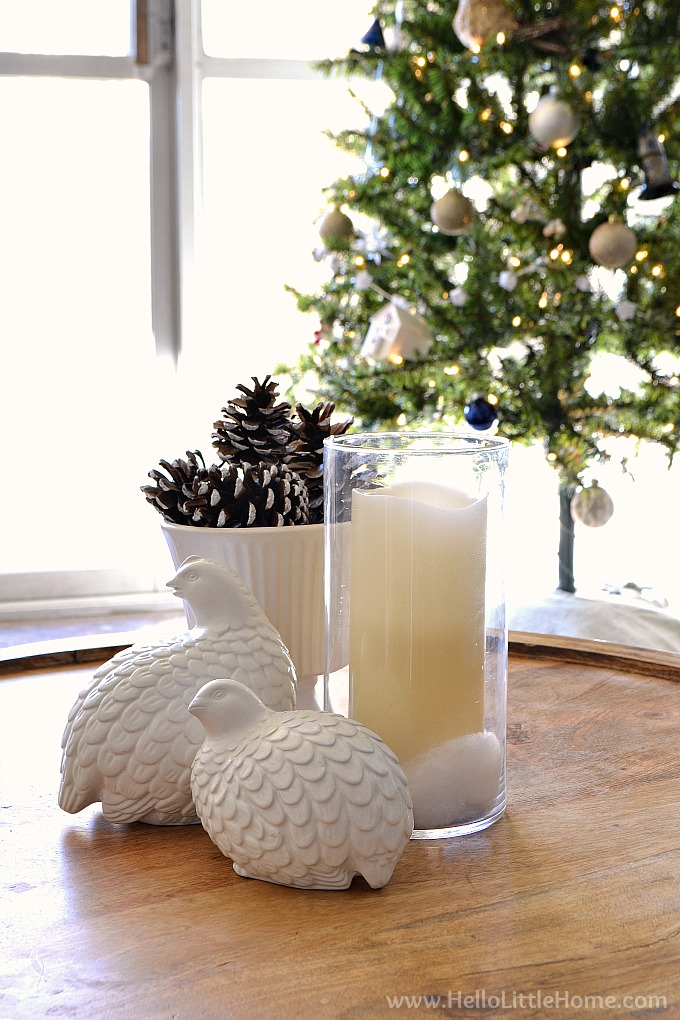 Modern Christmas Coffee Table Decorating Idea with Candles, White Birds, and Pine Cones