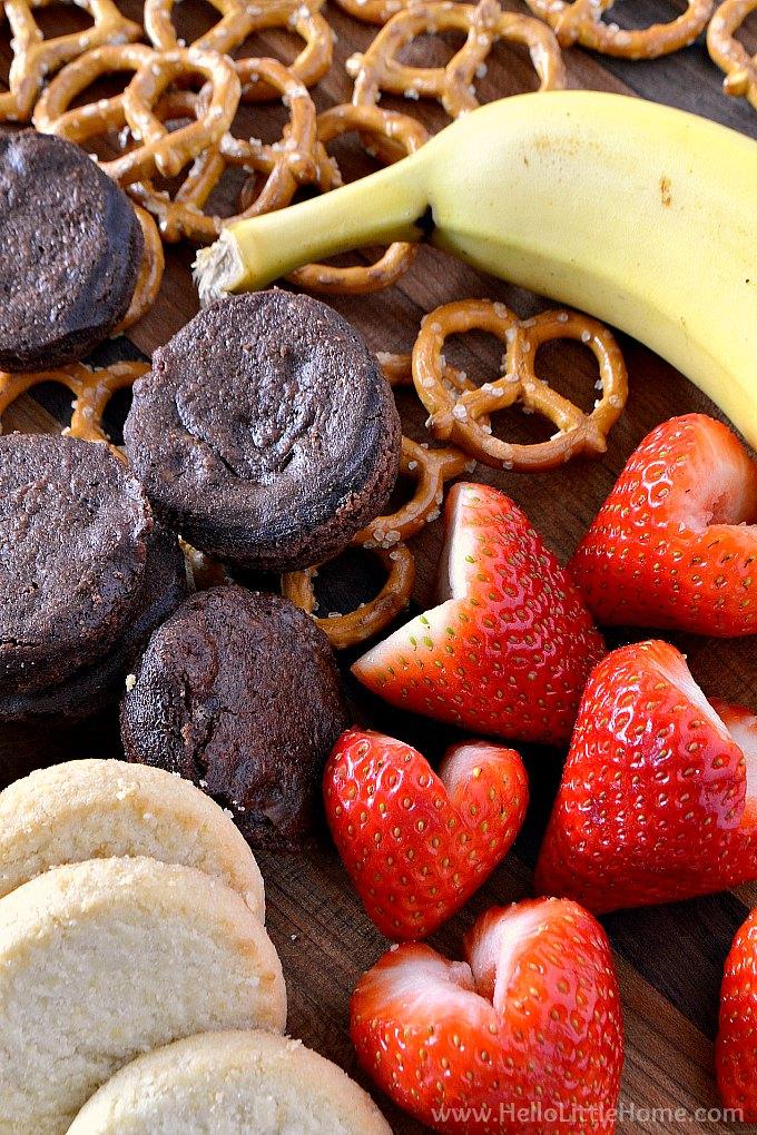 Chocolate fondue dippers: pretzels, brownie bites, bananas, strawberries, and shortbread cookies.
