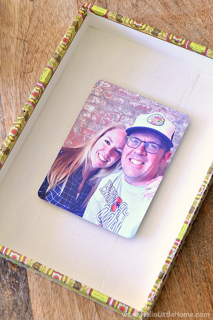 The finished DIY photo frame made from a cigar box.