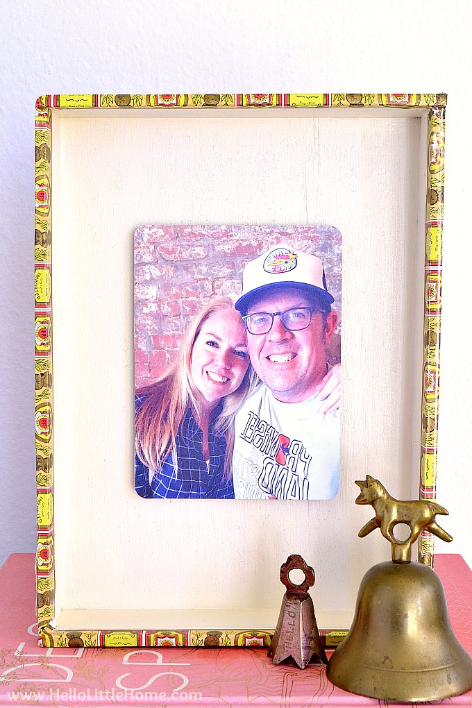 A DIY wood picture frame made from a cigar box.