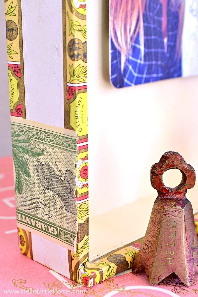 Closeup of a fun cigar box craft idea: a DIY picture frame.