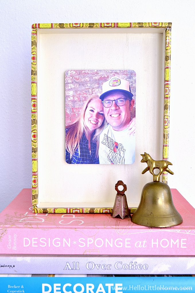DIY photo frame made from a cigar box displayed on a table.