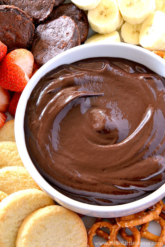 Closeup of an easy chocolate fondue recipe surrounded by dippers.