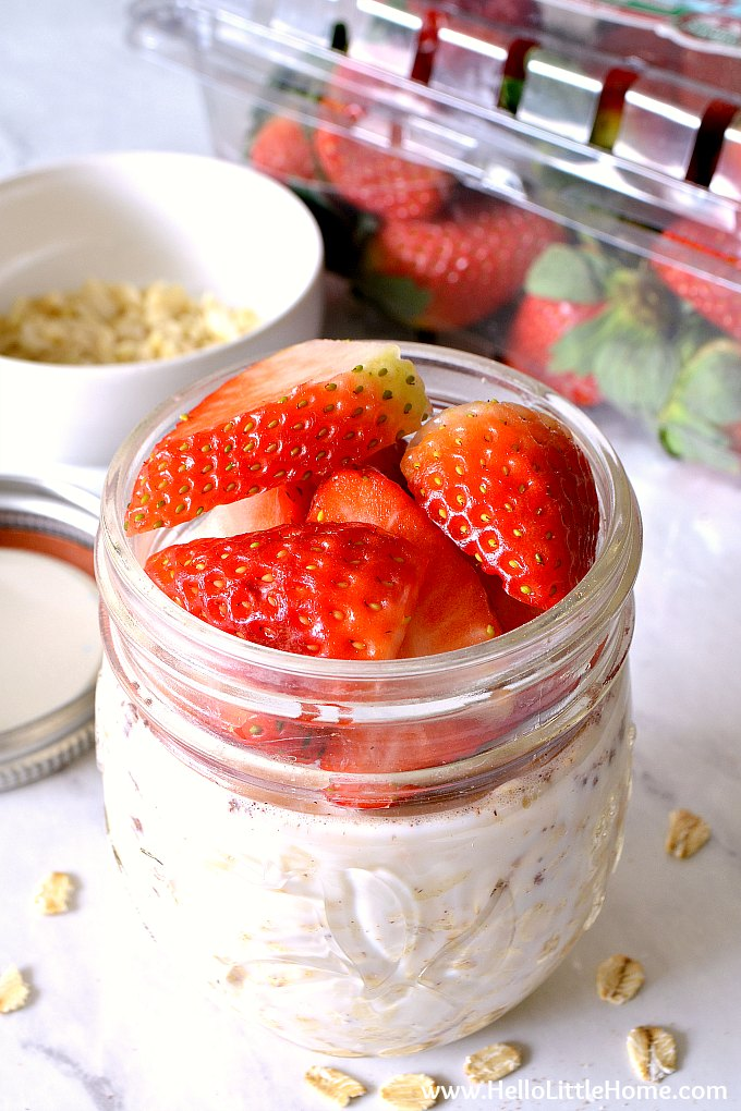 Easy overnight oats recipe topped with strawberries.