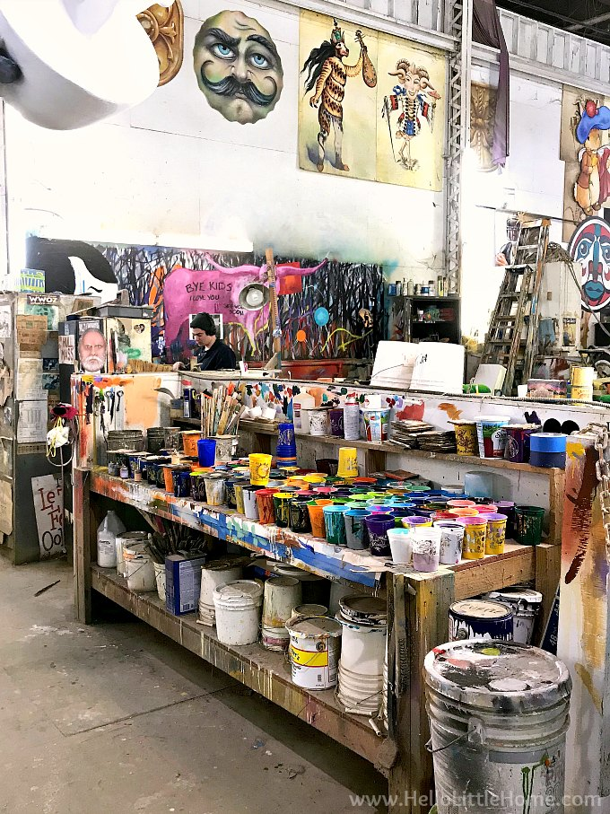 An artist painting Mardi Gras props in the New Orleans production facility and museum.
